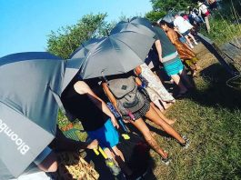 Don't Compare Yourself to Others — Here's Why   Photo of a crowd of people outside with umbrellas on a sunny day   Photo by Daye Deura