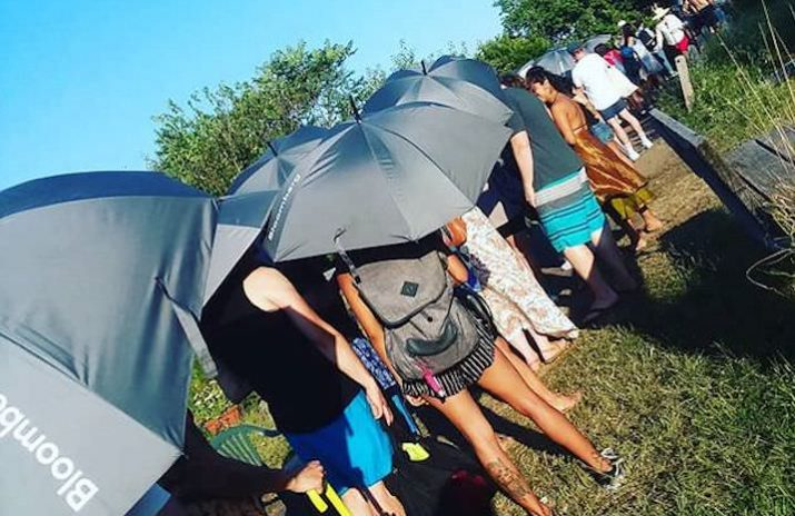 Don't Compare Yourself to Others — Here's Why | Photo of a crowd of people outside with umbrellas on a sunny day | Photo by Daye Deura
