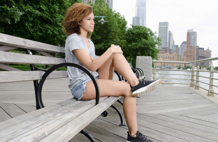 How to Deal With Student Debt and Depression | Photo of woman on bench at the waterfront | Photo by Eric Strausman