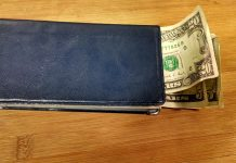 What Are Prepaid College Plans, and Are They Good Deals?   Photo of money sticking out of a checkbook   Photo by Evan Sachs