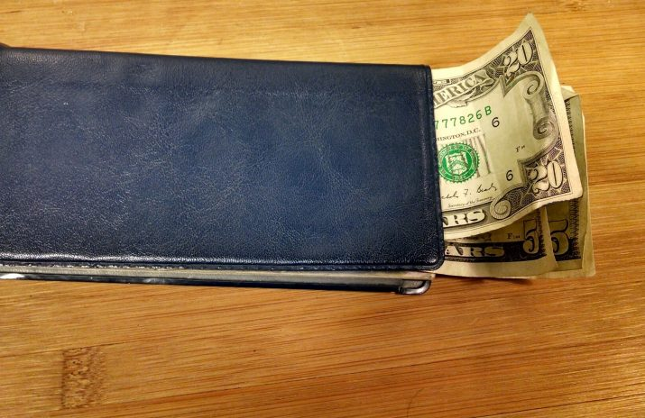 What Are Prepaid College Plans, and Are They Good Deals? | Photo of money sticking out of a checkbook | Photo by Evan Sachs