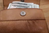 What to Do When You Can't Pay Medical Bills | Photo of a brown leather wallet with bills sticking out of it | Photo by Evan Sachs