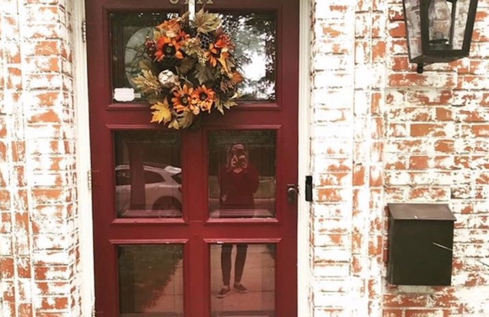 Financial Literacy for Kids: 7 Money Lessons From Halloween | Photo of a suburban door in autumn | Photo by Rita Pouppirt