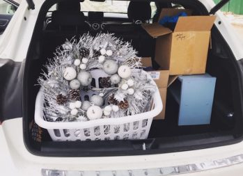 Holiday Budget Tips: Conquering Money Madness   Photo of a wreath and other holiday items in the trunk of a car   Photo by Rita Pouppirt