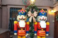 5 Great Ways to Celebrate Christmas Without Gifts | Photo of two giant nutcracker decorations next to a lamppost with a wreath on it | Photo by Daye Deura