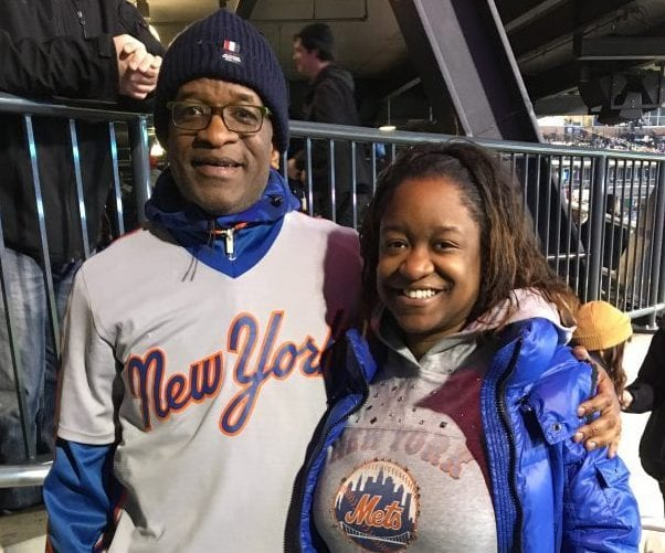 Kayla Nathaniel and her dad at a New York Mets game | Money Lessons My Dad Taught Me