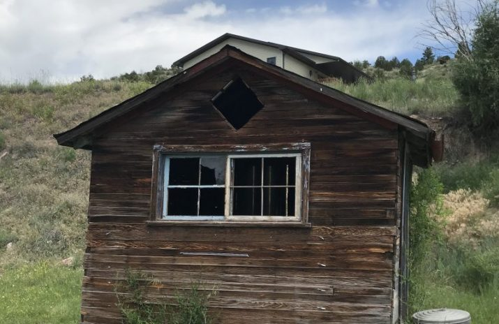 cabin in field in front of house | What Is a Reverse Mortgage, and Is It a Good Idea?
