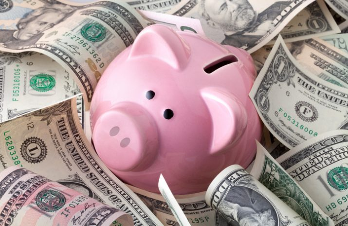 When to Start Saving for Retirement - piggy bank surrounded by money