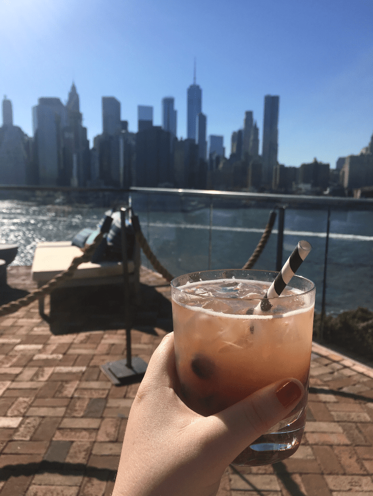"Kelly Meehan Brown enjoys a drink on a rooftop bar (""Independent Contractor Taxes, Rooftop Bars, and the True Meaning of Broke"")"