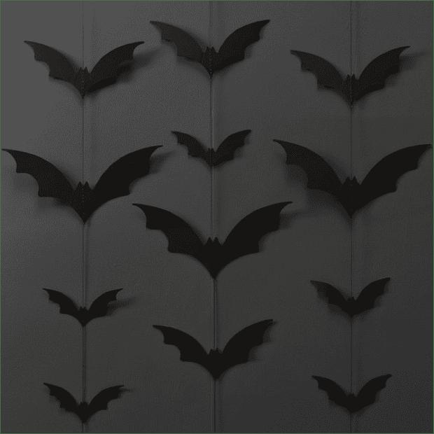 27 Cheap Halloween Party Ideas for Under $27: Bat paper garlands