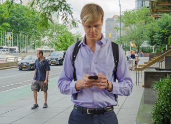These Cold Calling Tips Will Lead to Hot Deals | Photo of a man in a suit with a cell phone | Photo by Eric Strausman