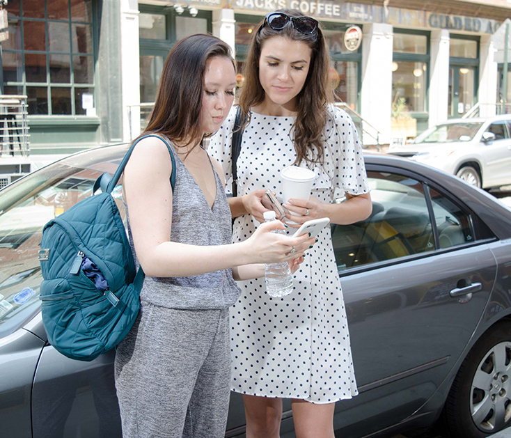 How to repair credit   Photo of two women looking at a cell phone   Photo by Eric Strausman