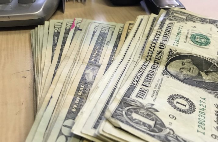 23 Weird Scholarships That Can Help You Afford College | Photo of cash on a desk | Photo by Rita Pouppirt