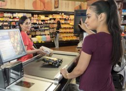What Is a Job Audition, and Should You Ever Do One?   Photo of a woman working as a cashier at a grocery store   Photo by Eric Strausman