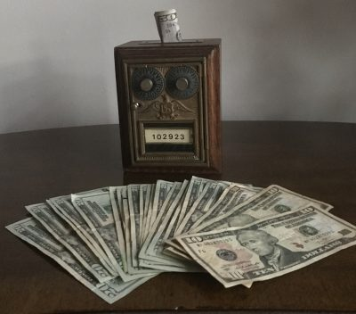 What is passive investing and how does it work? Active vs. passive investing | dollar bills on a table | Photo by Rita Pouppirt