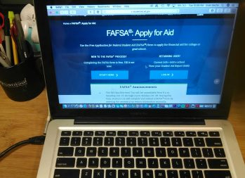 What Is the FAFSA and How Does It Work? A Guide | Laptop on desk with a window open to the FAFSA website | Photo by Evan Sachs
