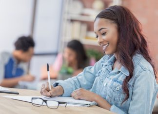 Young woman works on personal finnance financial literacy she did not learn in school