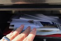 Taxes for the Self-Employed: What Is Schedule C and How Does It Work? | Photo of mail in a black mailbox | Photo by Rita Pouppirt