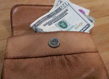 Why Are Payday Loans Bad? How Can I Steer Clear? | Photo of leather wallet with money in it | Photo by Evan Sachs