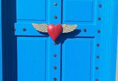 Life insurance and taxes   Photo of a red heart with wings on a blue door   Photo by Rita Pouppirt