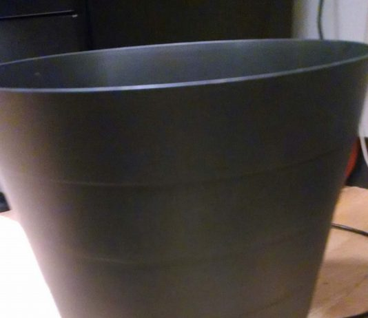 Your Guide to the Retirement Bucket Strategy | Photo of a black bucket | Photo by Evan Sachs