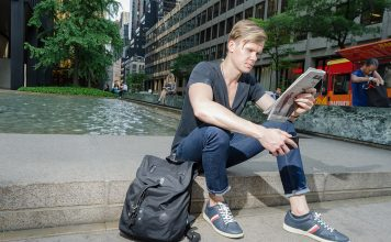 Understanding the stock market | Motley Fool Stock Advisor | Photo of man in New York reading a newspaper | Photo by Eric Strausman