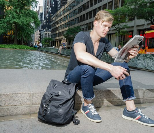 Understanding the stock market   Motley Fool Stock Advisor   Photo of man in New York reading a newspaper   Photo by Eric Strausman