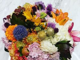 cost of attending a wedding | Photo of a bouquet of flowers | Photo by Daye Deura