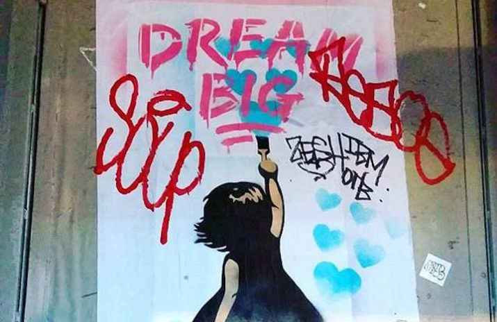 How to Stick to New Year's Resolutions and Meet Financial Goals   Graffiti of a girl painting the words
