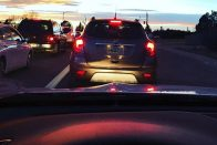 Lease or Buy a Car: Picking the Best Option | Photo of cars in traffic at sunset | Photo by Rita Pouppirt