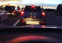 Lease or Buy a Car: Picking the Best Option   Photo of cars in traffic at sunset   Photo by Rita Pouppirt