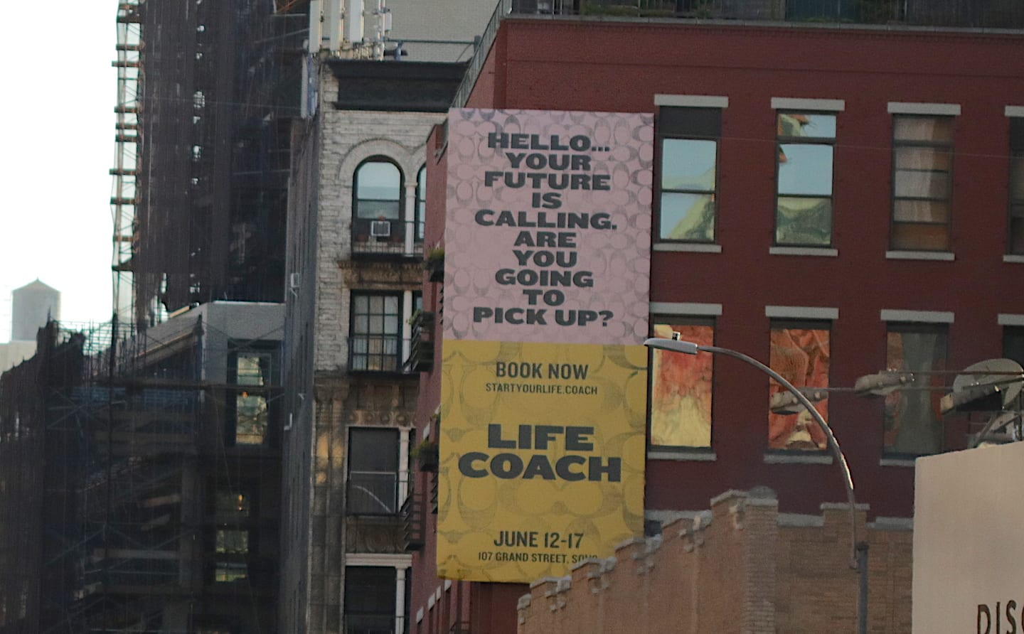 "Forget Making New Year's Resolutions — Take Action Instead | Photo of a large ad painted on the side of a brick building. It reads, ""Hello... Your future is calling. Are you going to pick up?"" 
