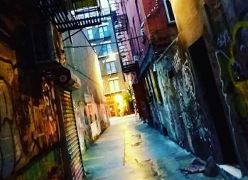How to Prepare for a Recession Before It's Too Late | A dark, creepy alley with graffiti | Photo by Daye Deura