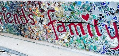 """What is wealth? What does wealthy mean, really?   mural that reads """"friends & family""""   Photo by Rita Pouppirt"""