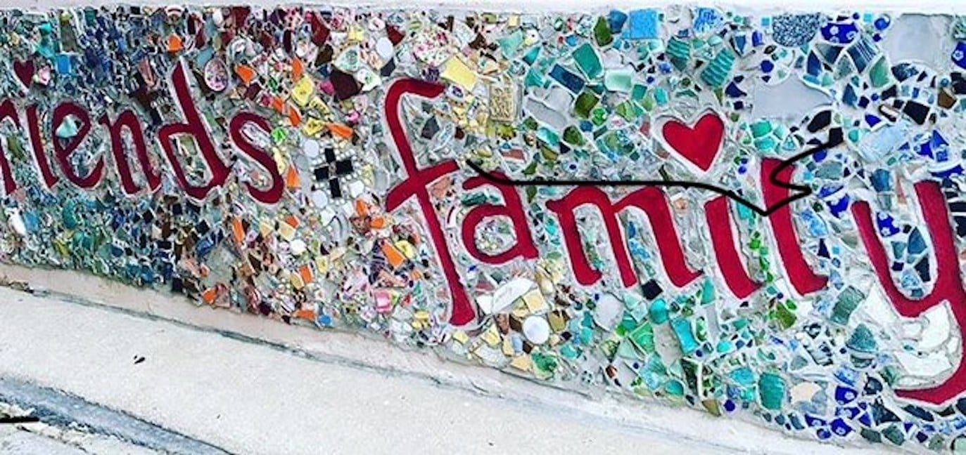 "What is wealth? What does wealthy mean, really? | mural that reads ""friends & family"" 